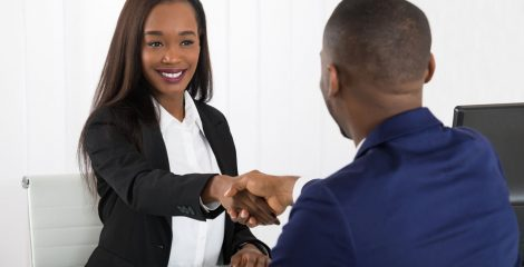 woman-shaking-hands-at-office